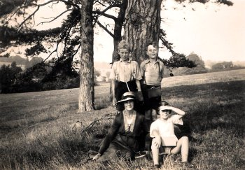 Dennis Bowden standing behind girl.  The woman with hat is his mother Alice Bowden nee Johnson.  Others Unknown.
