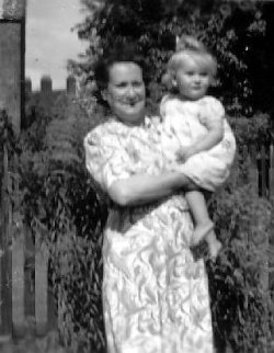 This photograph was taken in                                 September 1947 at 74 Shrewsbury Lane,                                 Shooters Hill, Plumstead and shows my                                 grandmother holding cousin Elizabeth.                                 Elizabeth is the daughter of Winnie and                                 Vic Hind.