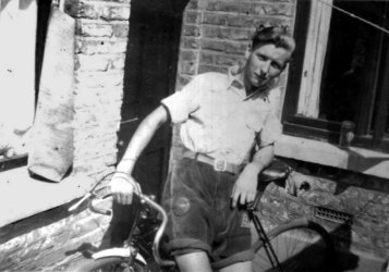 Sid aged 16 with his racing bike at back door Parkdale Road, Plums