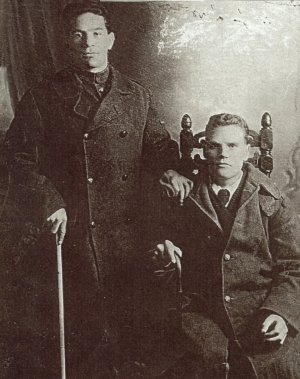 I do not know the story behind                                   this photo or where it was taken other                                   than it was in the early stages of the                                   First World War and both brothers were                                   on sick leave. Walter is wearing a tie                                   (it would have been red) which would                                   indicate he was a hospital patient and                                   both have sticks. There was a severe                                   epidemic of flu sweeping Europe at                                   that time. This photograph was sent to                                   me by my mother's cousin, Anthony                                   Brown, a nephew of Thomas and Walter                                   Wilson. Anthony devoted much time                                   tracing the footsteps of Walter Wilson                                   who tragically was unable to keep up                                   with his patrol in the desert when his                                   camel became lame. It was concluded he                                   had been killed by the enemy. His name                                   appears on a monument in Jerusalem.